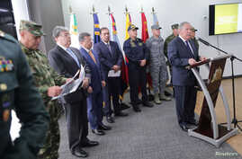 Colombian Defense Minister Guillermo Botero speaks during a news conference about Venezuela's President Nicolas Maduro's support for illegal Colombian armed groups operating from Venezuelan territory, in Bogota, Sept. 30, 2019.