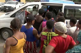 A still image taken from a video shows women, who were freed by police with other girls and women that were held captive, entering a bus in Lagos, Nigeria, September 30, 2019.