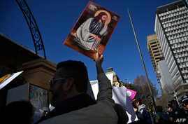 FILE - Pro-life and pro-choice advocates hold a protest rally outside the New South Wales Parliament in Sydney on Aug. 6, 2019.