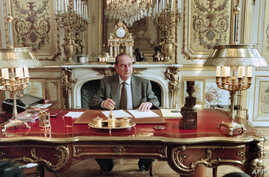 FILE - In this photo taken on Apr. 27, 1996, French President Jacques Chirac poses in his office at the Elysee palace in Paris.