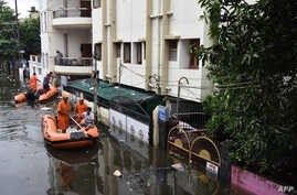 State Disaster Response Force (SDRF) personnel on boats travel along a flooded road of a residential neighborhood of Bahadurpur following heavy rainfalls in Patna in the Indian state of Bihar on Sept. 30, 2019.