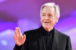 """French Greek director Costa-Gavras arrives for the screening of the film """"Adults in the Room"""" presented out of competition, and to the JLC Glory To The Filmmaker Award during the 76th Venice Film Festival at Venice Lido, Italy, Aug. 31, 2019."""