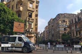 An Egyptian police van blocks a street leading to Cairo's Tahrir square, Sept. 27, 2019, in anticipation of anti-government protests.