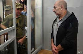 Vladimir Tsemakh, an Ukrainian man suspected of involvement in the downing of flight MH17, is about to leave a dock of Kiev court of appeal after the court verdict in Kyiv  on Sept. 5, 2019.