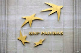 FILE - This Feb. 14, 2013, file photo shows BNP Paribas' logo at its headquarters in Paris, France.