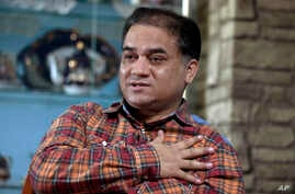 FILE - Ilham Tohti, an outspoken scholar of China's Turkic Uighur ethnic minority, speaks during an interview at his home in Beijing, China,  Feb. 4, 2013.