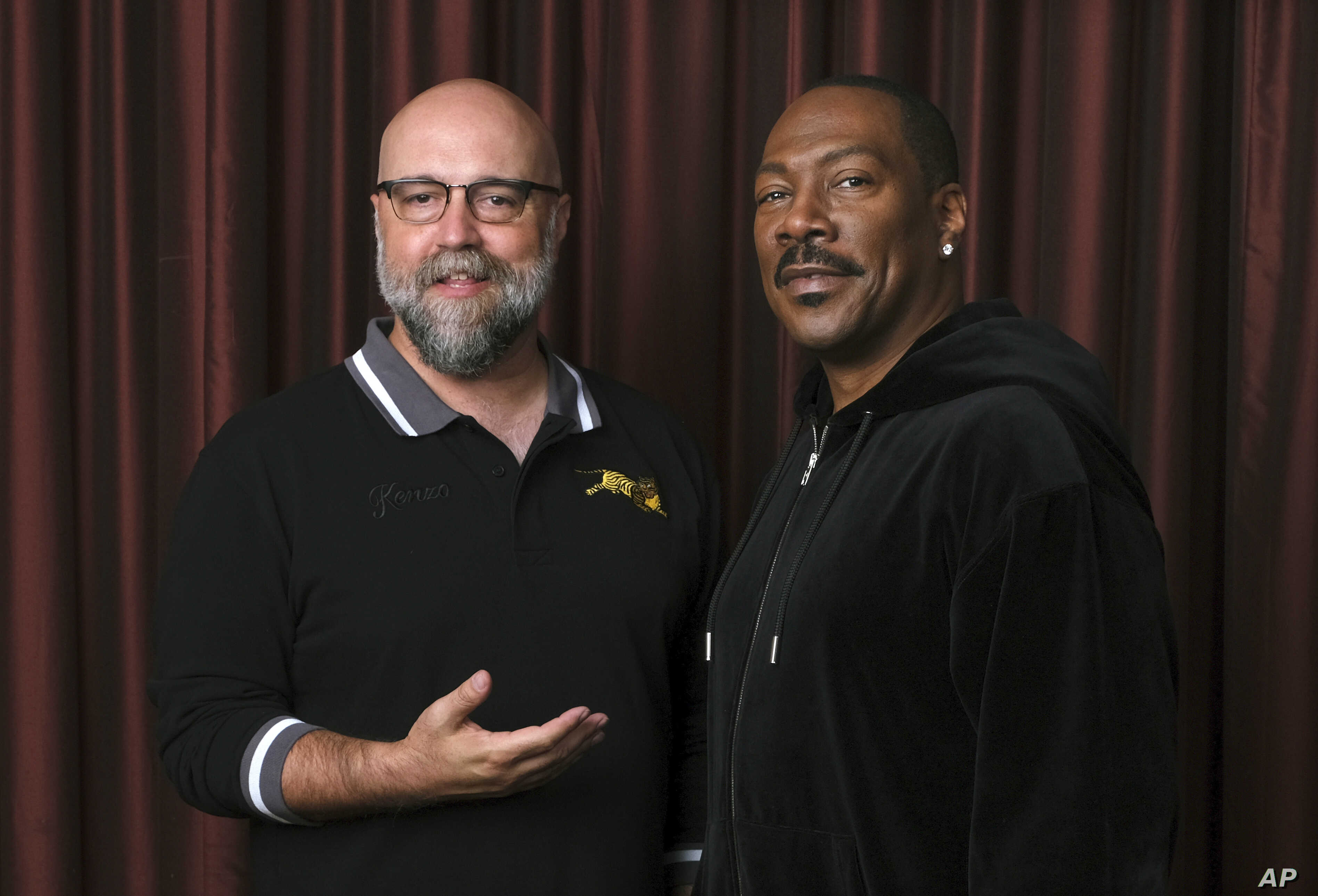 "Eddie Murphy, right, star of the film ""Dolemite Is My Name,"" poses with director Craig Brewer at the Shangri-La Hotel during the Toronto International Film Festival in Toronto, Sept. 7, 2019."