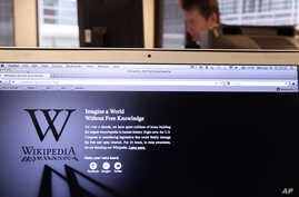 """FILE L- The webpage of the encyclopedia website Wikipedia shows a stark black-and-white page with the message: """"Imagine a world without free knowledge"""", at an office in Brussels, Belgium, Jan. 18, 2012."""