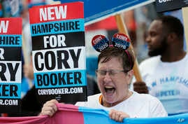 Cynthia Audesse, of Manchester, N.H., a supporter of Democratic presidential candidate Sen. Cory Booker, D-N.J, cheers during a rally outside the New Hampshire state Democratic Party convention,in Manchester, NH., Sept. 7, 2019.