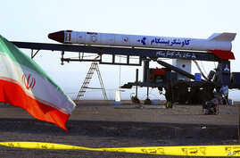 In this undated photo obtained from the Iranian Students News Agency, ISNA, a rocket dubbed, 'Pishgam,' or 'Pioneer' is seen ahead of a space launch at an undisclosed location in Iran.