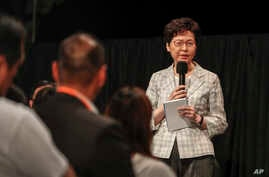 Hong Kong Chief Executive Carrie Lam speaks during a community dialogue with selected participants at the Queen Elizabeth Stadium in Hong Kong, Sept. 26, 2019.