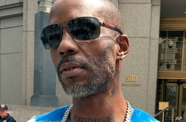 FILE - Rapper DMX, whose given name is Earl Simmons, leaves federal court in New York, Aug. 11, 2017.