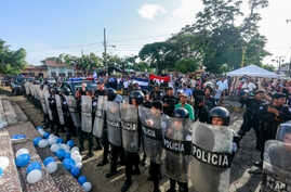 Police form a cordon outside a church where a Mass is celebrated for the freedom of political prisoners, in Masaya, Nicaragua, Aug. 28, 2019.