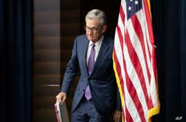 FILE - U.S. Federal Reserve Chairman Jerome Powell walks to the podium during a news conference in Washington, July 31, 2019.