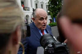 FILE - President Donald Trump's lawyer Rudy Giuliani speaks to reporter's on the South Lawn of the White House in Washington, May 30, 2018.