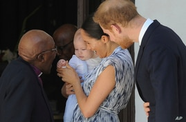 Britain's Prince Harry and Meghan, Duchess of Sussex, holding their son Archie, meets with Anglican Archbishop Emeritus, Desmond Tutu, in Cape Town, South Africa, Sept. 25, 2019.
