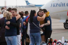 Relatives of Ukrainian prisoners freed by Russia greet them upon their arrival at Boryspil airport, outside Kyiv, Ukraine, Sept. 7, 2019.