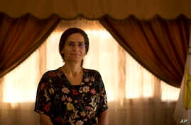 FILE - Ilham Ahmed, co-chair of the executive committee of the U.S-backed Syrian Democratic Council, speaks during an interview in Darbasiyah, Syria, Sept. 3, 2019.