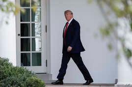 President Donald Trump walks towards the Oval Office of the White House in Washington, Sept. 26, 2019.