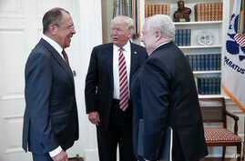 FILE - In this image provided by the Russian Foreign Ministry, President Donald Trump meets with Russian Foreign Minister Sergey Lavrov, left, and then-Russian Ambassador to the U.S. Sergei Kislyak, at the White House in Washington, on May 10, 2017.
