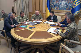 FILE - Ukrainian President Volodymyr Zelenskiy, third right, attends a meeting with Ukrainian top military officials in Kyiv, Ukraine, Aug. 7, 2019. (Ukrainian Presidential Press Office via AP)