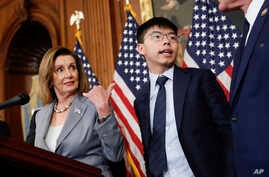 House Speaker Nancy Pelosi is seen with Hong Kong activist Joshua Wong, right, during a news conference on Hong Kong human rights on Capitol Hill, in Washington, Sept. 18, 2019.