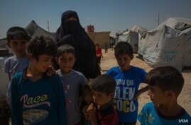 At least 50,000 children are detained at al-Hol with their mothers. Many of them are sons and daughters of IS fighters who died or are in prison, in al Hol, Aug. 26, 2019. (Yan Boechat/VOA)
