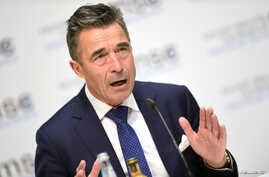 FILE - Anders Fogh Rasmussen, former NATO secretary-general, speaks during the annual Munich Security Conference in Munich, Germany, Feb. 16, 2019.