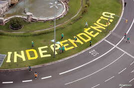 FILE - The word 'Independencia' (independence) is seen on a roundabout before a rally dedicated to Catalonia's national day, in Barcelona, Spain, Sept. 11, 2019.