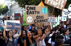 Activists march in a climate change rally in London, Britain, Sept. 20, 2019.