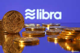 """Representations of Facebook's virtual currency """"Libra"""" are displayed in an illustration picture, June 21, 2019."""