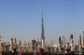 FILE - General view of Dubai'FILE - General view of Dubai's cranes at a construction site in Dubai, UAE, Dec. 18, 2018.s cranes at a construction site in Dubai, UAE, Dec. 18, 2018.