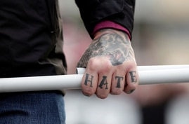 FILE - A tattoo is seen on a hand of a supporter of Italy's far-right Forza Nuova party during a demonstration in Rome, Italy, Nov. 4, 2017.