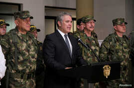 Colombia's President Ivan Duque speaks next to commanders of military forces in Popayan, Sept. 12, 2019.