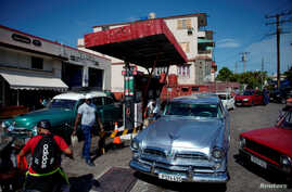 FILE - Cars line up to buy fuel at a gas station in Havana, Cuba, July 19, 2019.