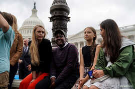 Swedish youth climate activist Greta Thunber, 16,  sits on the side among other youth climate activists at a news conference about the Green New Deal hosted by U.S. Senator Ed Markey (D-MA)  in front of the U.S. Capitol in Washington, Sept. 17, 2019