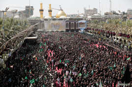 Shi'ite pilgrims gather during the religious festival of Ashura in the holy city of Kerbala, Iraq, Sept. 10, 2019.