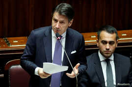 Italian Prime Minister Giuseppe Conte presents his government's programme as 5-Star Movement leader Luigi di Maio sits next to him, ahead of confidence vote at the Parliament in Rome, Italy, Sept. 9, 2019.