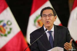Peru's President Martin Vizcarra addresses the nation, as he announces he was dissolving Congress, at the government palace in Lima, Peru, Sept. 30, 2019.