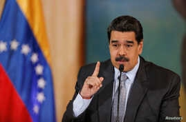 Venezuela's President Nicolas Maduro gestures as he speaks during a news conference in Caracas, Venezuela, Sept. 30, 2019.