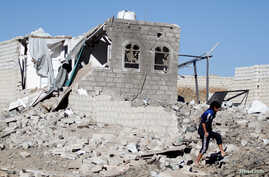 A boy is seen at the site of an airstrike launched by the Saudi-led coalition in Sana'a, Yemen, Feb. 1, 2019.