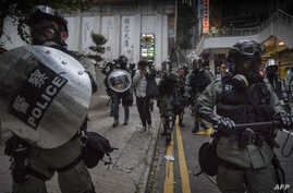 Police arrest a protester in the Wanchai area of Hong Kong on October 1, 2019, as the city observes the National Day holiday to…