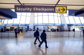 Sign points to a Transportation Security Administration (TSA) checkpoint at Dulles International Airport in Dulles, Va.
