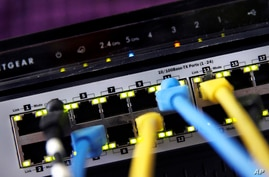 FILE - A router and internet switch are displayed in East Derry, N.H., June 19, 2018.