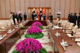 Pakistani Prime Minister Imran Khan, back second from left, speaks with Chinese Premier Li Keqiang, back third from left, during a signing ceremony at the Diaoyutai State Guesthouse in Beijing, April 28, 2019.