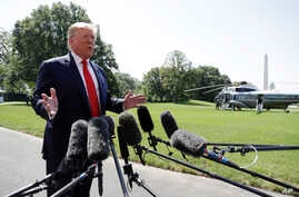 President Donald Trump talks to reporters on the South Lawn of the White House before departing for his Bedminster, N.J. golf…