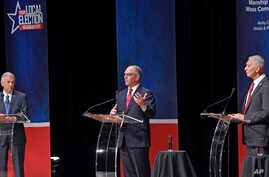 From left, Eddie Rispone, Gov. John Bel Edwards and Republican Rep. Ralph Abraham participate in the first televised gubernatorial debate Thursday Sept. 19, 2019, in Baton Rouge, Louisiana.