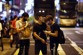Protesters wear masks on the streets of Hong Kong on Friday, Oct. 4, 2019. Masked protesters streamed into Hong Kong streets…