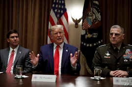 President Donald Trump, joined by from left, Defense Secretary Mark Esper, and Chairman of the Joint Chiefs of Staff Gen. Mark…