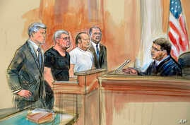 This courtroom sketch depicts from left, attorney Kevin Downing, Lev Parnas, Igor Fruman, attorney Thomas Zehnle and U.S. Judge…